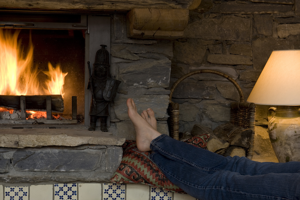 warming-feet-in-front-of-fire-at-chalet-merlo-pic-mark-junak