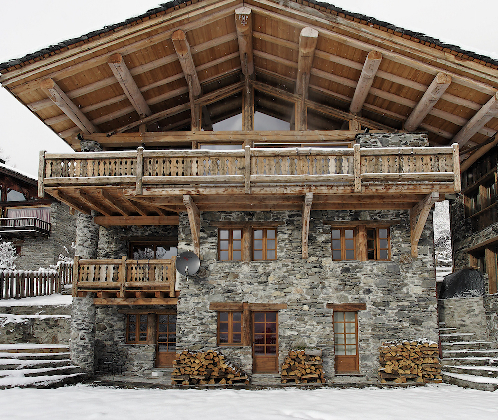 front-view-of-chalet-merlo-with-clearing-skies-after-a-snowfall-2