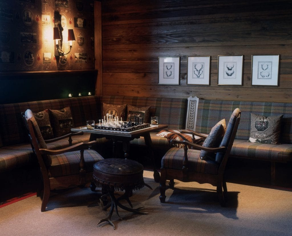 Cosy Alpine living room with table and chess set