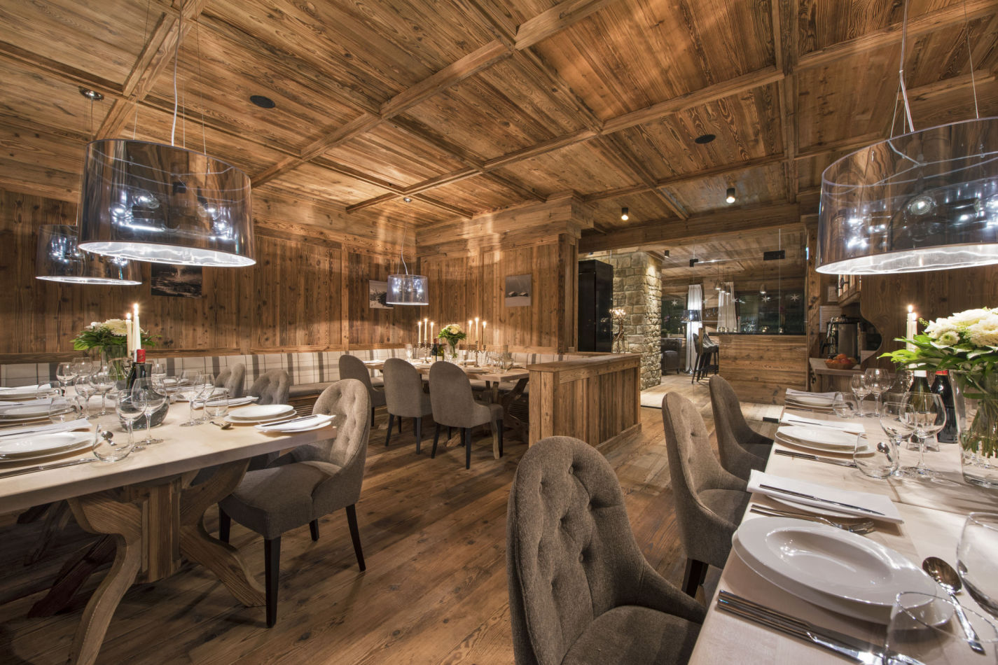 The expansive timber-clad dining room of Chalet Eden Rock