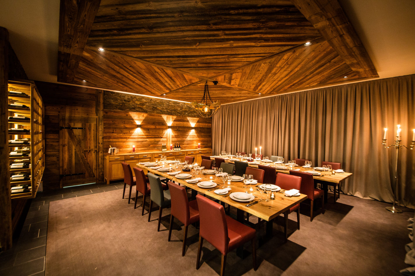 St Anton's Montford Lodge's impressive wooden dining area with timber-clad walls and ceiling