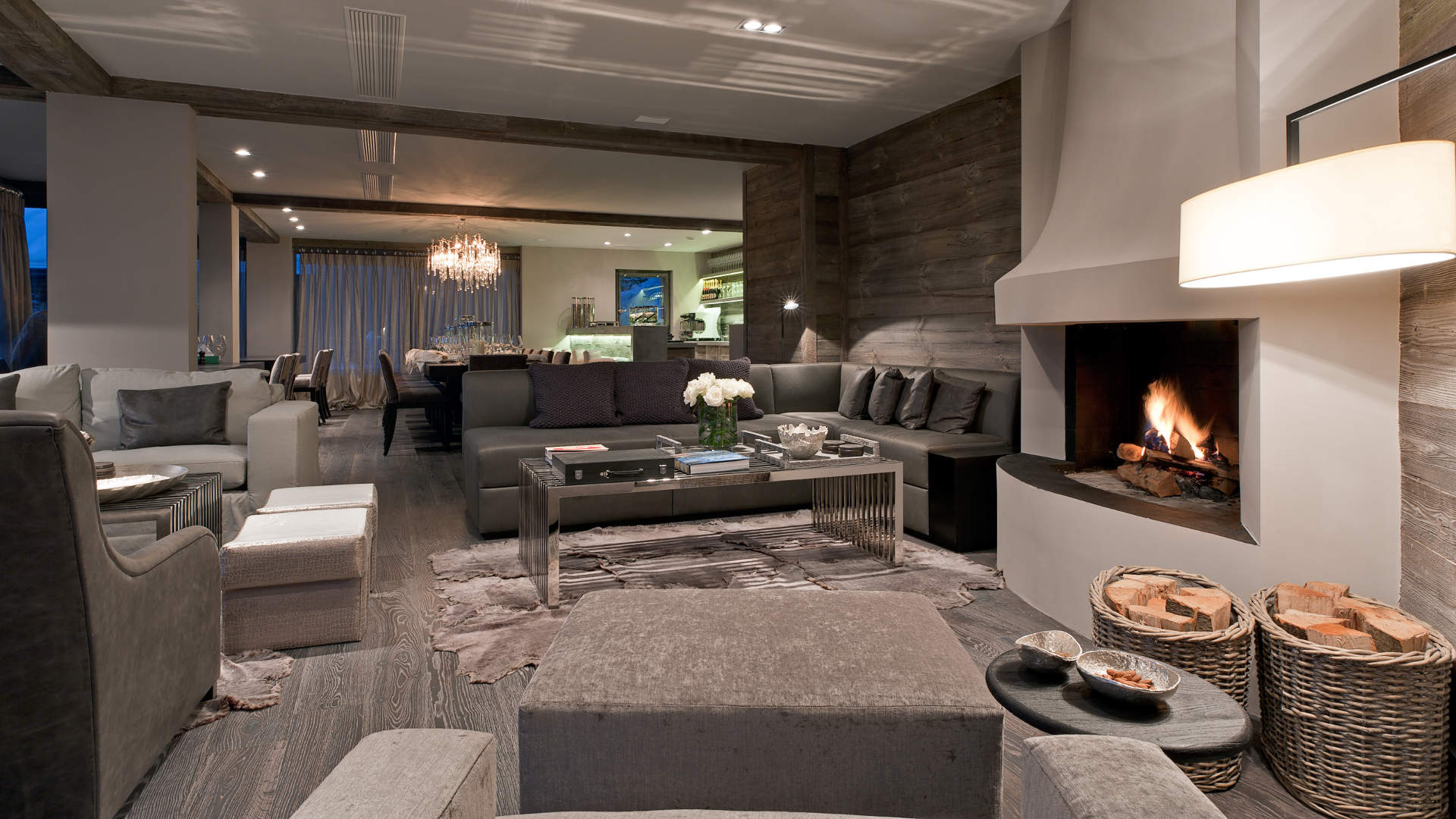 Chalet number 14 living room with roaring fire and luxury interiors