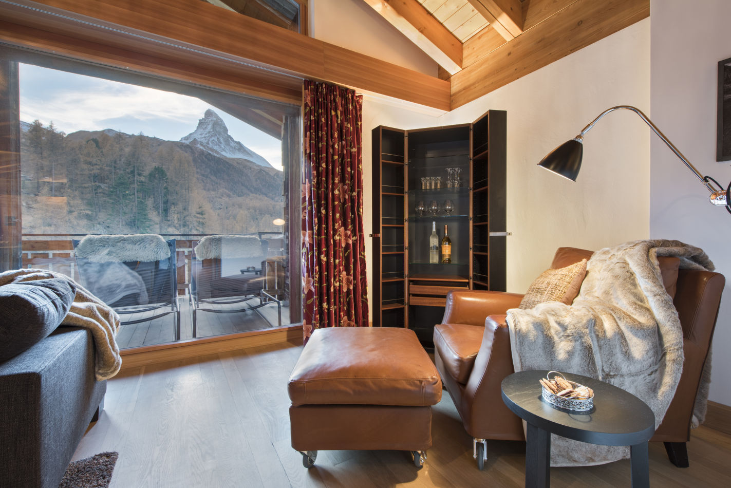 The view of Zermatt's Matterhorn can be seen peering through one of the bedroom's of Chalet Shalimar