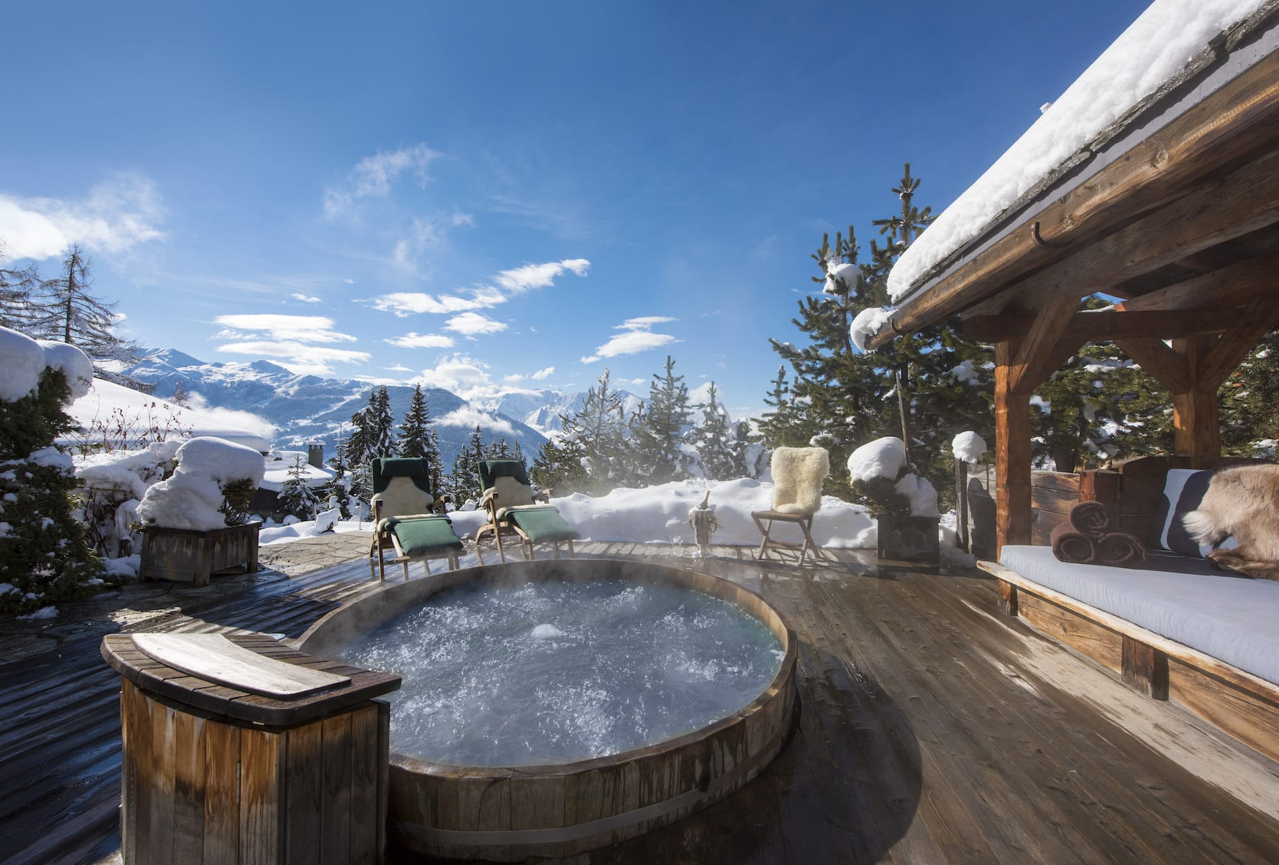 Chalet Le Ti outside view with hot tub