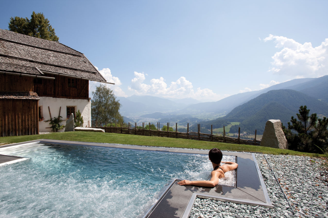Chalet San Lorenzo outdoor swim spa with woman watching the view