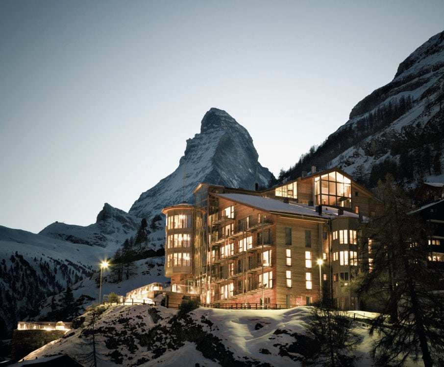 The Matterhorn looms over Hotel Omnia in Zermatt, Switzerland at dusk.