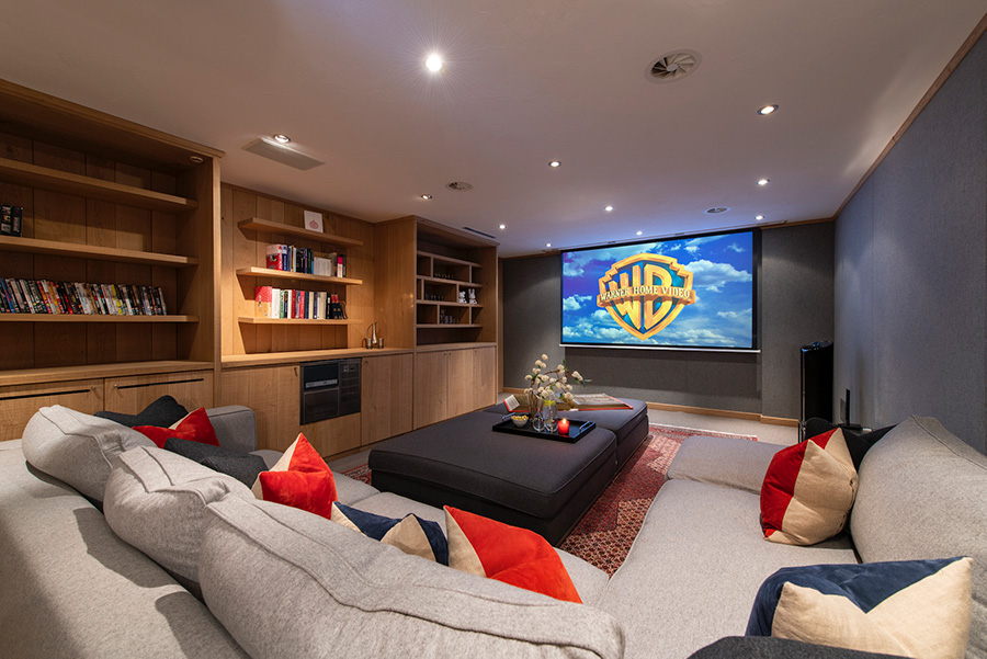 Chalet Le Tigre TV room with projector screen and cinema system