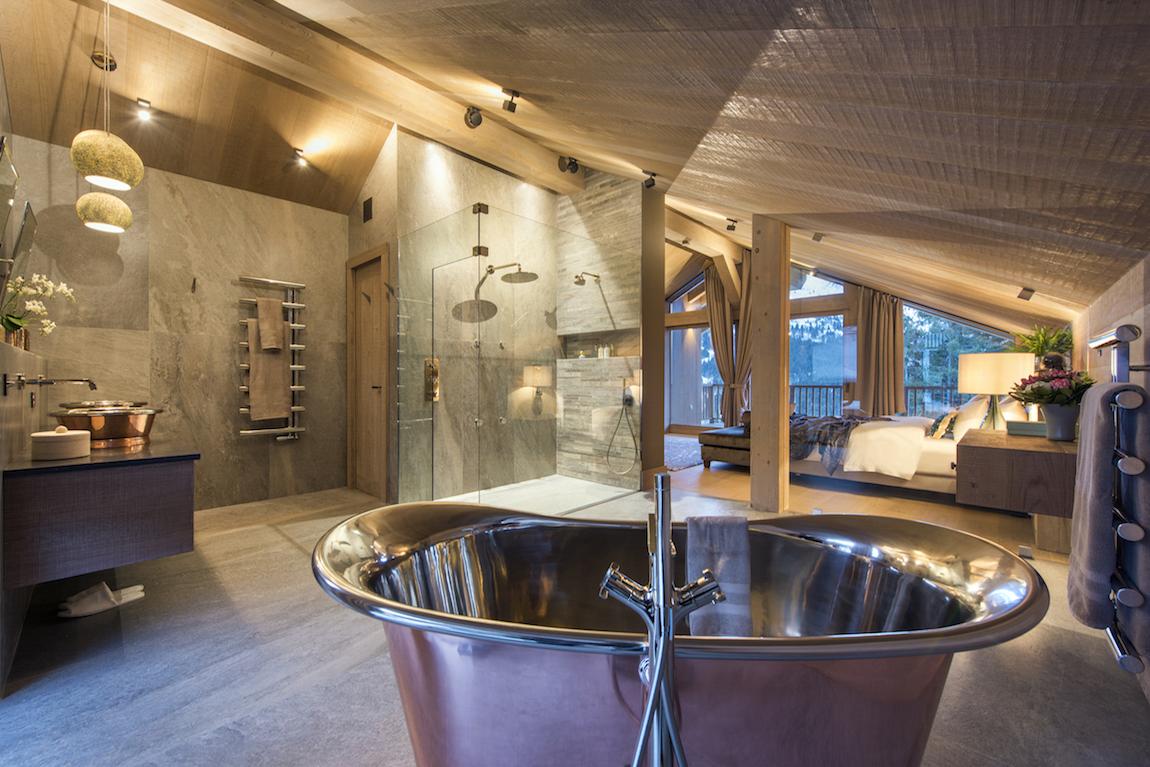 Chalet Alpaca bedroom scene with metal hot tub.